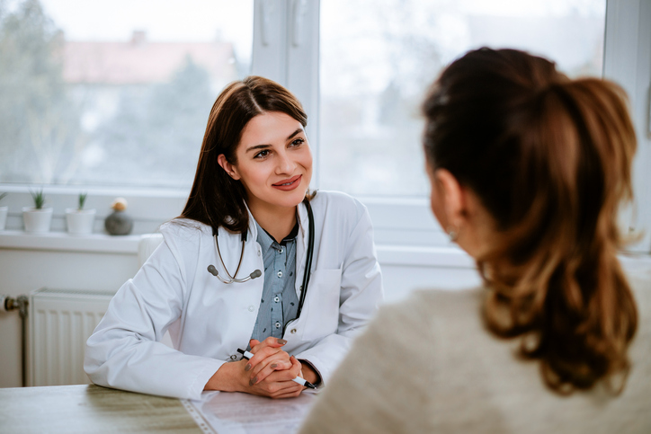 Doctor talks with female patient
