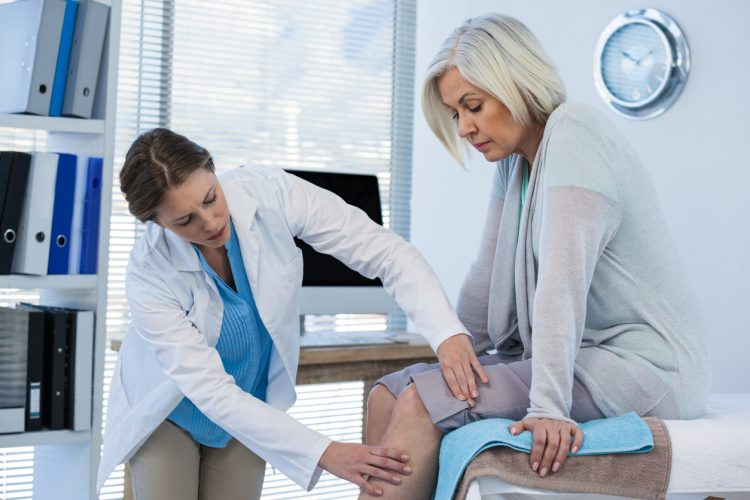 Doctor checks patient for DVT